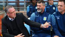 Manager Paul Lambert (L) of Aston Villa talks to assistant Roy Keane during the Premier League match between Aston Villa and Newcastle United .  Michael Regan/Getty Images