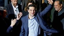 Head of radical leftist Syriza party Alexis Tsipras waves while leaving the party headquarters after winning the elections in Athens. Reuters