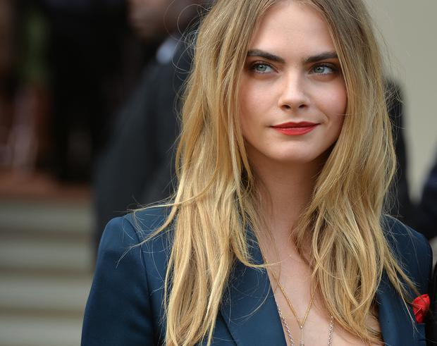 Cara Delevingne attends the Burberry Prorsum show during London Fashion Week Spring Summer 2015 on September 15, 2014 in London, England. (Photo by Anthony Harvey/Getty Images)