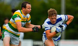 David Whelton of Castlehaven is tackled by Alan Jennings of Carbery Rangers
