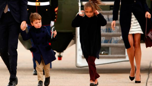 U.S. President Donald Trump's grandson Joseph Kushner (L) holds a toy helicopter as he and his sister Arabella Kushner (R), with their parents Jared Kushner and Ivanka Trump, board Air Force One with the president for travel to Florida from Joint Base Andrews, Maryland, U.S. March 3, 2017. REUTERS/Jonathan Ernst