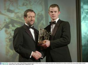 28 November 2003; Tommy Walsh, Kilkenny, is presented with his All-Star award by GAA President Sean Kelly at the VODAFONE GAA All-Star Awards in the Citywest Hotel, Dublin. Football. Hurling. Picture credit; Brendan Moran / SPORTSFILE *EDI*
