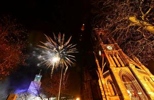 Fireworks over the church of St Thomas the martyr at the New Year's eve Winter Carnival in Newcastle city centre. Photo: Owen Humphreys/PA Wire