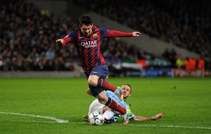 Manchester City's Martin Demichelis brings down Barcelona's Lionel Messi to concede a penalty and receives a red card during the UEFA Champions League, Round of 16 match at the Etihad Stadium.