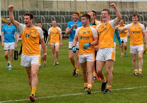 Antrim players from left, Conor Murray, Patrick McBride, and Owen Gallagher celebrate after the game