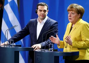 German Chancellor Angela Merkel and Greek Prime Minister Alexis Tsipras address a news conference following talks at the Chancellery in Berlin March 23, 2015.  Tsipras, pressing for cash to keep his country afloat, began talks with Merkel on Monday after Berlin ruled out any breakthrough in differences with the euro zone over Athens's international bailout.     REUTERS/Hannibal Hanschke