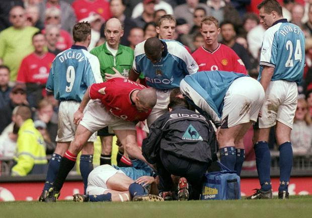 Roy Keane rages at Alf Inge Haaland as their rivalry reached boiling point in 2001.