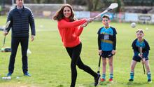 The Duchess of Cambridge tries out hurling during a visit to a local Gaelic Athletic Association (GAA) club to learn more about traditional sports during the third day of their visit to the Republic of Ireland