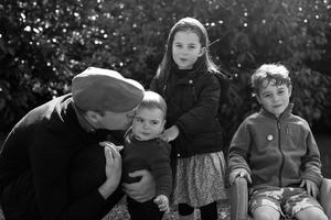 An undated handout photo issued by Kensington Palace of Britain's Prince William, Duke of Cambridge, Prince Louis, Princess Charlotte and Prince George taken in Norfolk earlier this year by Catherine, Duchess of Cambridge, obtained on December 25, 2019.