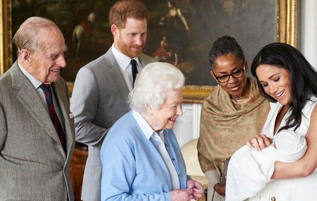Prince Harry and Meghan Markle hold their baby son Archie Harrison Mountbatten-Windsor as Queen Elizabeth, Prince Philip and Doria Ragland look on. Picture: Chris Allerton/@sussexroyal