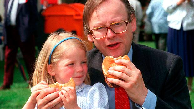 MEAT CRISIS: John Gummer and his four-year-old daughter Cordelia with beef burgers during the BSE crisis of 1990. Photo: PA