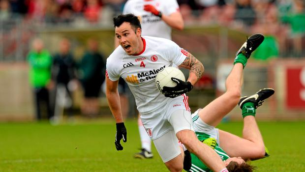 28 June 2015; Cathal McCarron, Tyrone, in action against Cian Sheehan, Limerick. GAA Football All-Ireland Senior Championship, Round 1B, Tyrone v Limerick. Healy Park, Omagh, Co. Tyrone. Picture credit: Oliver McVeigh / SPORTSFILE