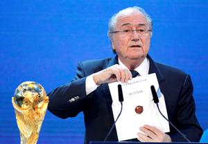 In this Thursday, Dec. 2, 2010 photo FIFA President Sepp Blatter announces Russia to host the 2018 World Cup during the announcement of the host country for the 2018 soccer World Cup in Zurich, Switzerland (AP Photo/Michael Probst, File)