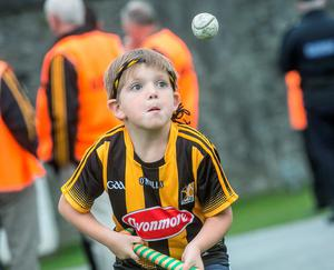 7/9/2015: Seven year old Daniel darwich from Dunamaggin in Co Kilkenny was still working on his skills while waitinf for the Kilkenny team bus to arrive at Kilkenny Castle. Photo: Pat Moore.