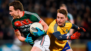 Andy Moran gives Roscommon's Niall McInerney the slip on Saturday night. Photo:  Seb Daly/Sportsfile