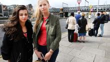 Louise Hannigan and Hannah Mc Kee, from Belfast, waiting for a bus at the Custom House