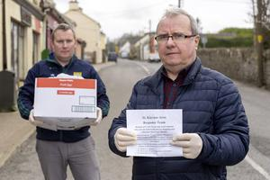 Solidarity: Volunteer Ivan Neary with Paul Moriarty, from Ardagh, Co Limerick, who has organised a local community shopping group of 82 volunteers to help older people. Photo: Don Moloney