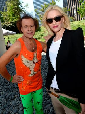 """Richard Simmons (L) and Gwen Stefani attend the Elizabeth Glaser Pediatric AIDS Foundation's 24th Annual """"A Time For Heroes"""" at Century Park on June 2, 2013 in Los Angeles, California.  (Photo by Michael Buckner/Getty Images for EGPAF)"""