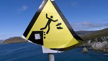"""""""Confused by this one!"""" says Celia Nydahl, who snapped this sign on Achill Island. """"If you have big feet there will be trouble..."""""""