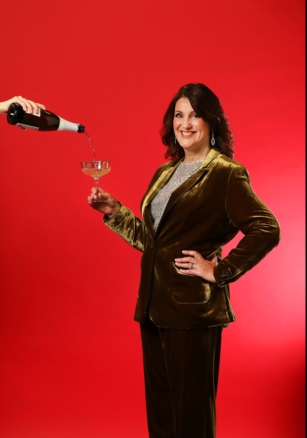 Wine buff: Corinna Hardgrave. Photo by Steve Humphreys Makeup by John Bowes for Brown Sugar. Blazer, €120, trousers, €75, both Marks and Spencer; top, €47, River Island