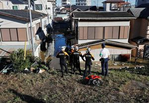 Rescue workers from the Kawasaki City Fire Department look at a flooded residential area due to Typhoon Hagibis, near the Tama River in Kawasaki, Japan, October 13, 2019. REUTERS/Kim Kyung-Hoon
