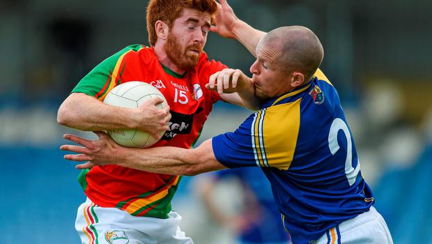 Daryl Roberts brushes off a tackle from Longford captain Dermot Brad