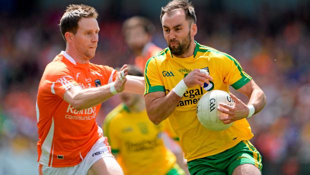 14 June 2015; Karl Lacey, Donegal, in action against Finnian Moriarty, Armagh. Ulster GAA Football Senior Championship Quarter-Final, Armagh v Donegal. Athletic Grounds, Armagh. Picture credit: Brendan Moran / SPORTSFILE