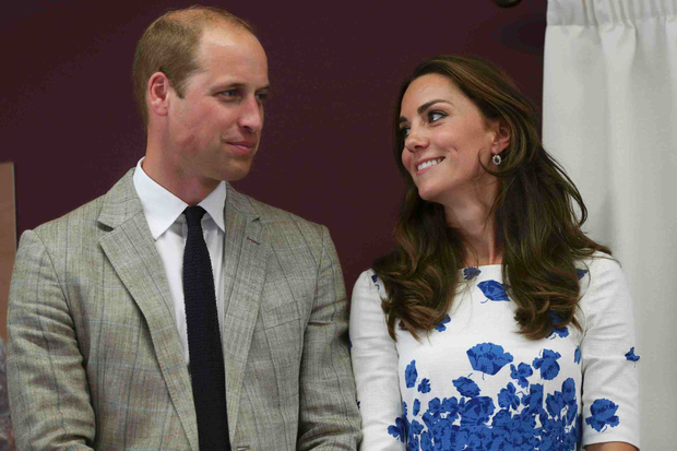 Kate Middleton and Prince William listen to a speech during their visit to Keech Hospice Care in Luton, north of London, on August 24, 2016. Photo: EDDIE KEOGH/AFP/Getty Images