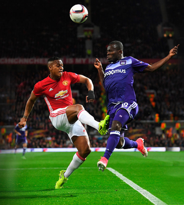 Manchester United's Antonio Valencia of beats Anderlecht's Frank Acheampong to the ball during their Europa League quarter-final, second leg match at Old Trafford last night. Photo: Laurence Griffiths/Getty Images
