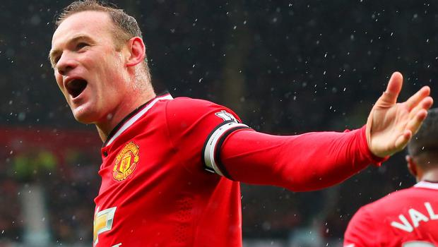 Wayne Rooney celebrates as Manchester United run riot against their city rivals at Old Trafford on Sunday