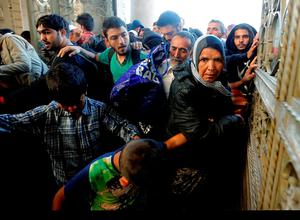 Migrants enter the main gate at the railway station in Budapest, Hungary, Thursday, Sept. 3, 2015. Over 150,000 migrants have reached Hungary this year, most coming through the southern border with Serbia, and many apply for asylum but quickly try to leave for richer EU countries.(AP Photo/Frank Augstein)