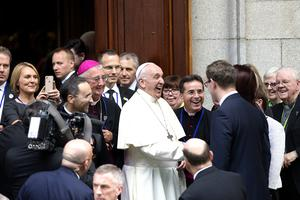 Pope Francis leaves the Pro Cathedral after speaking at a couples ceremony. Photo: Tony Gavin