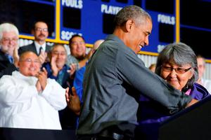 U.S. President Barack Obama (2nd R) embraces Kivalina Tribal Council President Millie Hawley as she introduces him to deliver remarks on climate change in Kotzebue, Alaska September 2, 2015. The stop makes Obama the first sitting U.S. president to visit a community north of the Arctic Circle, a trek the White House hopes will bring into focus how climate change is affecting Americans. REUTERS/Jonathan Ernst
