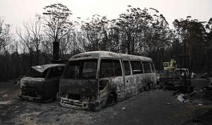 Vehicles gutted by bushfires are seen in the Lake Conjola area, New South Wales. Photo: Getty Images