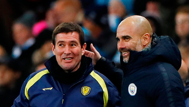 Manchester City manager Pep Guardiola shares a joke with Nigel Clough. Photo: Reuters