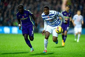 Manchester City's Bacary Sagna and Queens Park Rangers' Leroy Fer battle for the ball