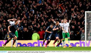 Scotland's Shaun Maloney, right, celebrates after scoring his side's first goal with team-mates as Republic of Ireland players look on.