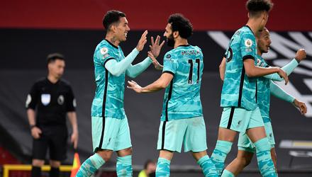 Liverpool's Roberto Firmino (left) celebrates scoring their third goal of the game with teammate Mohamed Salah (right) during the Premier League match at Old Trafford, Manchester.