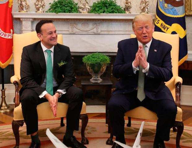 Taoiseach Leo Varadkar (left) and US President Donald Trump greeting each other with a Namaste gesture in the Oval Office at the White House in Washington DC during the Taoiseach's visit to the US. Photo: Niall Carson/PA Wire