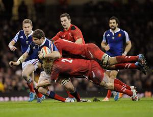Wales' Richard Hibbard (lower R) and Taulupe Faletau tackle France's Pascal Pape during the Six Nations Championship rugby union match at the Millennium Stadium, Cardiff.