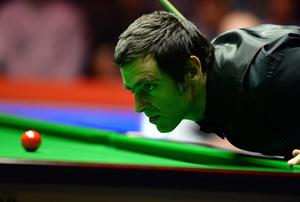 Ronnie O'Sullivan at the table in his semi final match against Stuart Bingham
