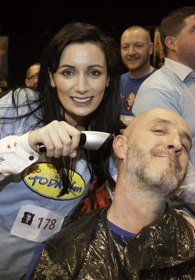 Louise Duffy shaves Martin Maguire both from Today FM during Today FM's Shave or Dye 2014 Guinness World Record attempt at the Mansion House, Dublin. Photo: Gareth Chaney Collins