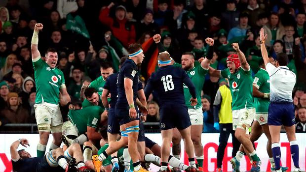Ireland celebrate after preventing Scotland from scoring a last-minute try during the Guinness Six Nations match at the Aviva Stadium, Dublin. Photo credit: Niall Carson/PA Wire.