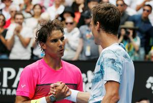 Tomas Berdych of the Czech Republic shakes hands with Rafael Nadal of Spain after defeating him in their men's singles quarter-final match at the Australian Open in Melbourne