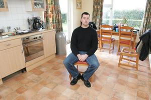 Rachel O' Reilly' s husband Joe sits in the empty kitchen of their family home  Photo: Kyran O' Brien