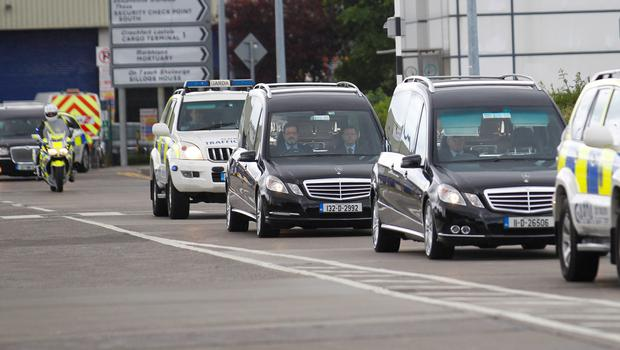 The bodies of four of the Irish students who died after a balcony collapsed in Berkeley, California arrive back at Dublin Airport, Ireland, Sunday, June 21. Six students were killed when the fourth-floor balcony they were standing on collapsed during a party at the student accommodation block in Berkeley California on Tuesday (AP Photo/Peter Morrison)