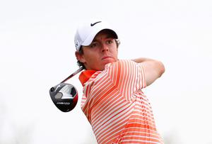Rory McIlroy watches his tee shot on the second hole during his match against Boo Weekley in Arizona yesterday