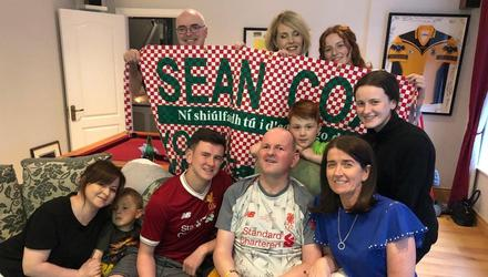 Elated: Sean Cox with his family