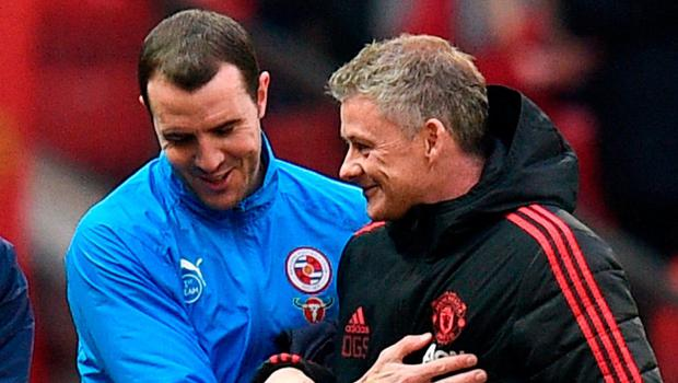 Old team-mates John O'Shea, now of Reading, and Ole Gunnar Solskjaer greet each other. Photo: Oli Scarff/AFP/Getty Images