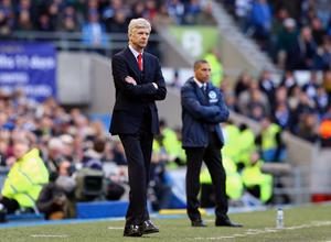 Arsenal manager Arsene Wenger and Brighton & Hove Albion manager Chris Hughton on the touchline during the FA Cup Fourth Round match at the AMEX Stadium, Brighton. PRESS ASSOCIATION Photo. Picture date: Sunday January 25, 2015. See PA story SOCCER Brighton. Photo credit should read: Gareth Fuller/PA Wire. RESTRICTIONS: Editorial use only. Maximum 45 images during a match. No video emulation or promotion as 'live'. No use in games, competitions, merchandise, betting or single club/player services. No use with unofficial audio, video, data, fixtures or club/league logos.